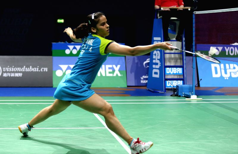 Indian badminton player Saina Nehwal in action against her Chinese counterpart Wang Shixian during the first Women's Singles match of Group A of the Badminton World Federation (BWF) ...