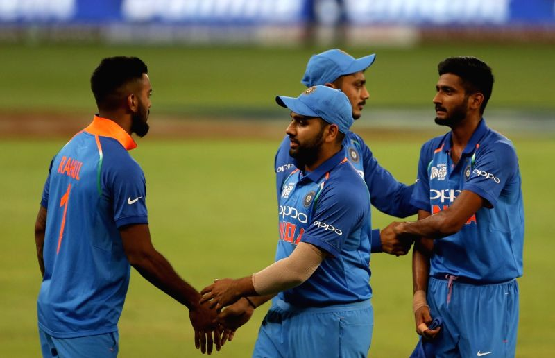 : Dubai: Indian cricketers celebrate after winning the fourth match (Group A) of Asia Cup 2018 against Hong Kong at Dubai International Cricket Stadium on Sept 18, 2018. .