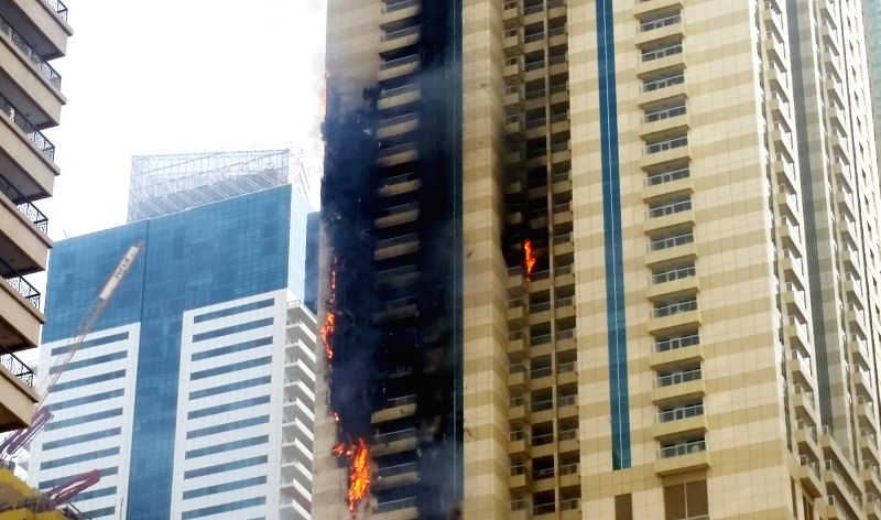 DUBAI, July 20, 2016 - Photo taken on July 20, 2016, shows flames and smoke engulf several floors of Sufala Tower in Dubai, UAE. The 75-storey high Sufala Tower in Dubai caught fire Wednesday in the ...
