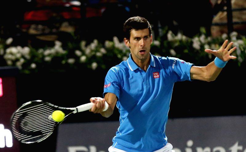 Novak Djokovic of Serbia returns the ball during the final match against Roger Federer of Switzerland on the fifth day of the ATP Dubai Duty Free Tennis Championships ...