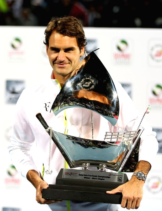 Roger Federer of Switzerland poses with his trophy after winning the final match against Novak Djokovic of Serbia on the fifth day of the ATP Dubai Duty Free Tennis ...