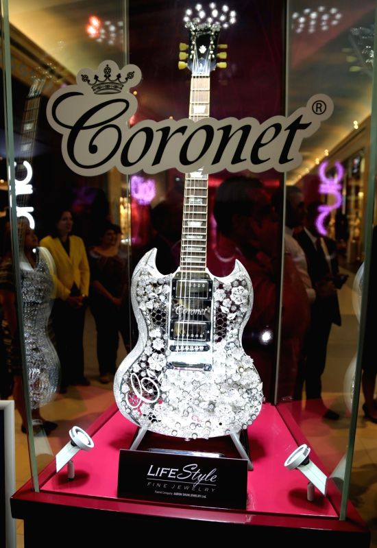 "Coronet's diamond guitar, which sets a Guinness World record for ""Most Valuable Guitar"", is shown in Dubai, United Arab Emirates (UAE). The guitar is decorated with over 400 carats of diamonds set in approximately 1.6 kilograms of gold. The showpiece is estimated to be worth 2 million US dollars."