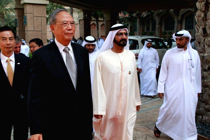 Dubai (U.A.E): Vice chairman of the Boao Forum for Asia Zeng Peiyan (1st L, Front) and United Arab Emirates (UAE) Vice President, Prime Minister and Dubai ruler Sheikh Mohammed Bin Rashid Al-Maktoum .
