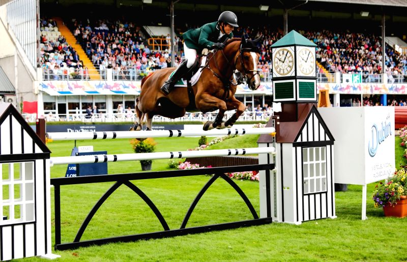 DUBLIN, Aug. 11, 2018 - A rider takes a jump during FEI Jumping Nations Cup of Ireland in Dublin, Ireland, Aug. 10, 2018.