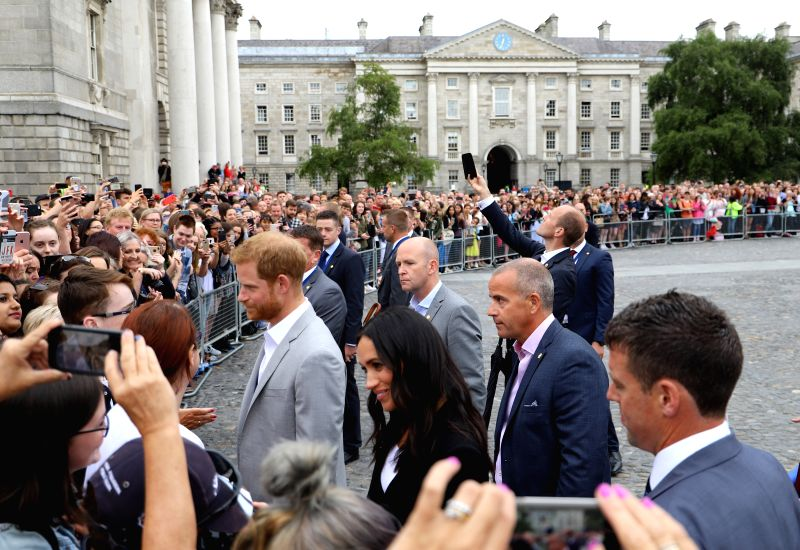 DUBLIN, July 12, 2018 - Britain's Prince Harry (1st L, inside the fence) and his wife Meghan Markle meet with the public at the Trinity College Dublin in Dublin, Ireland, July 11, 2018. Britain's ...