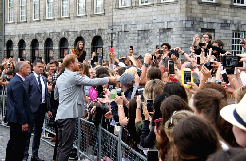 DUBLIN, July 12, 2018 - Britain's Prince Harry (3rd L, front) shakes hands with people at the Trinity College Dublin in Dublin, Ireland, July 11, 2018. Britain's Prince Harry and his wife Meghan ...