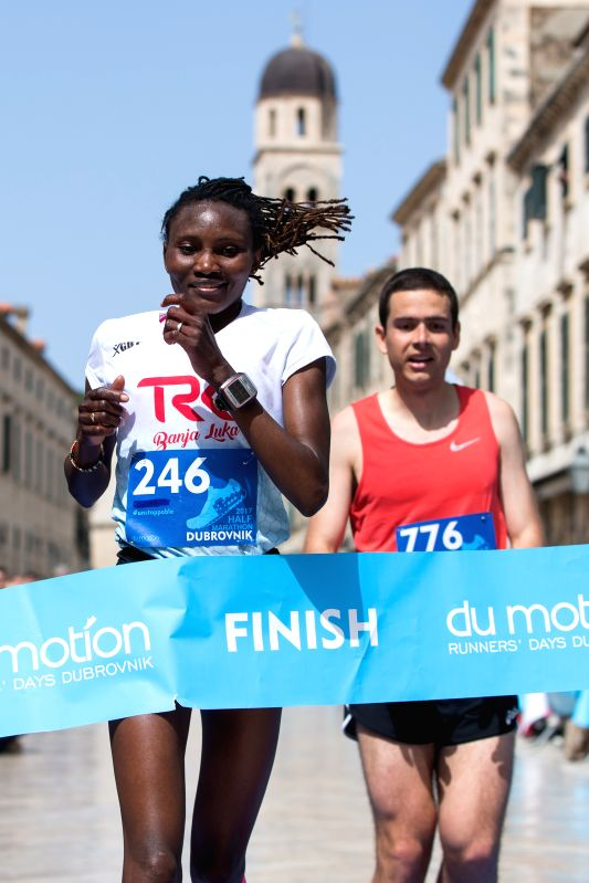 DUBROVNIK, April 30, 2017 - Lucia Kimani (L) of Bosnia and Herzegovina crosses the finish line during the Dubrovnik Half Marathon Race in Dubrovnik, coast city of Croatia, April 30, 2017. Lucia ...