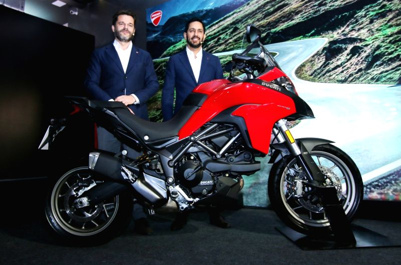 Ducati India Sales Director Sergi Canovas and Ducati India Managing Director Ravi Avalur (L-R) unveil the Ducati Multistrada 950 in New Delhi, on June 14, 2017.