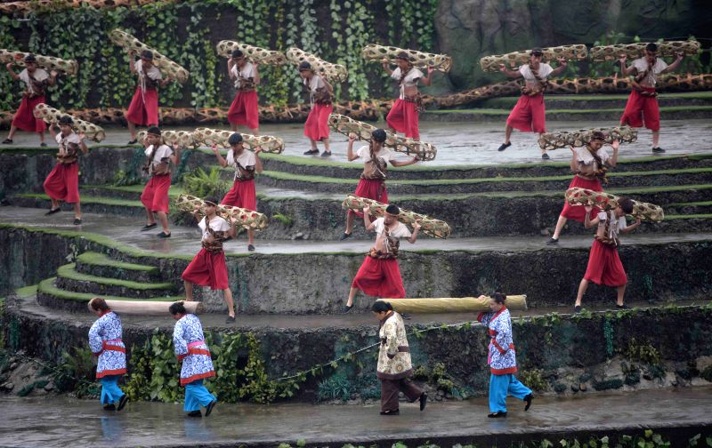 People perform during a ceremony to offer sacrifices to water at the Dujiang Dam, an ancient but still operating irrigation project, in southwest China's Sichuan ...