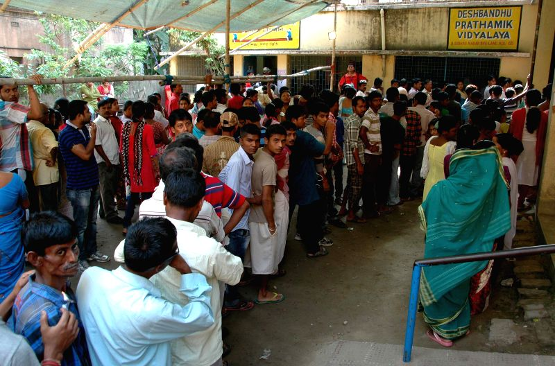 Dum Dum: People queue-up at a polling station to cast their vote South Dum Dum Municipality Polls in North 24 Parganas on April 25, 2015.
