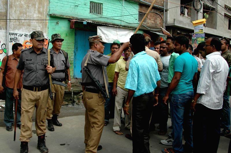 Dum Dum:  Security personnel intervene as two political groups clash during South Dum Dum Municipality Polls in North 24 Parganas on April 25, 2015.