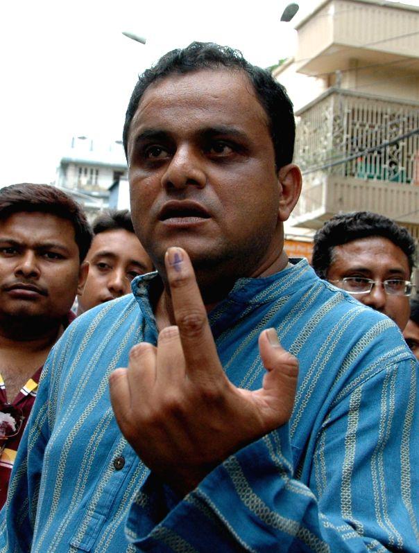 Dum Dum: West Bengal Tourism Minister Bratya Basu after casting his vote during South Dum Dum Municipality Polls in North 24 Parganas of West Bengal on April 25, 2015.