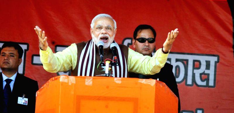 Prime Minister Narendra Modi addresses a rally in Dumka of Jharkhand  on Dec 15, 2014. - Narendra Modi