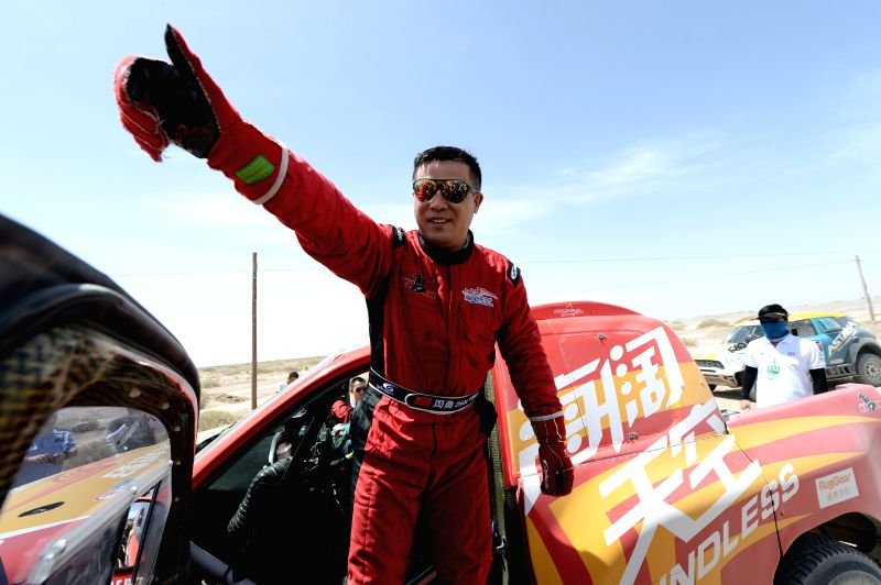 DUNHUANG, July 19, 2016 - Boundless Young Team driver Zhou Yong of China reacts after the 10th special stage of the Silkway Rally in Dunhuang, northwest China's Gansu Province, on July 19, 2016.