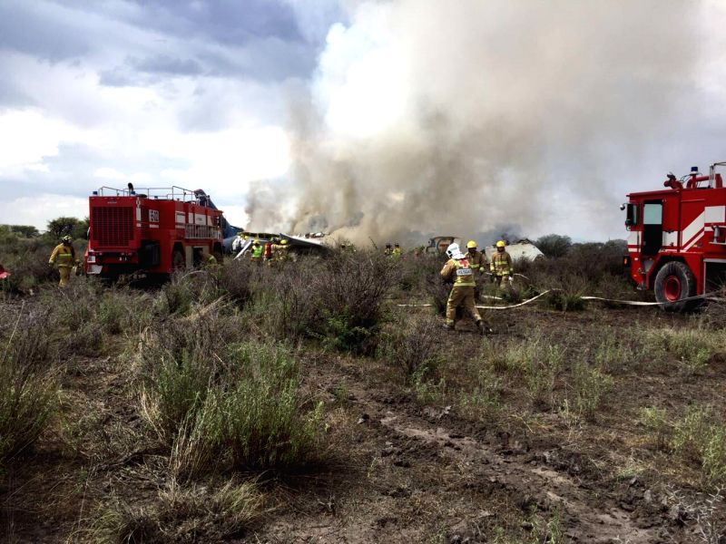 DURANGO, July 31, 2018 - Photo taken with a mobile phone and provided by Durango's Civil Protection Department shows rescuers working on the site where a plane crashed in Durango, Mexico, on July 31, ...
