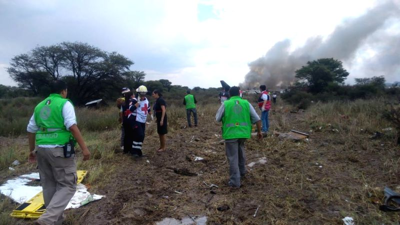 DURANGO, July 31, 2018 - Photo taken with a mobile phone and provided by Durango's Civil Protection Department shows rescuers working at the site where a plane crashed in Durango, Mexico, on July 31, ...