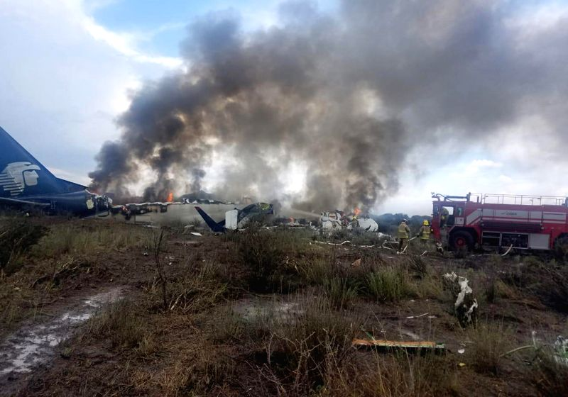 DURANGO, July 31, 2018 - Rescuers work at the site where a plane crashed in Durango, Mexico, on July 31, 2018. An Aeromexico plane carrying more than 100 people crashed in the northern Mexican state ...