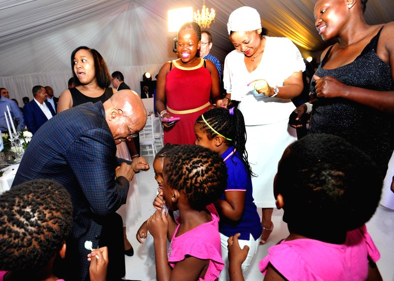 South Africa's President Jacob Zuma (1st L) dances with his family members during a private family gathering at the presidential official residence in Durban, South ...