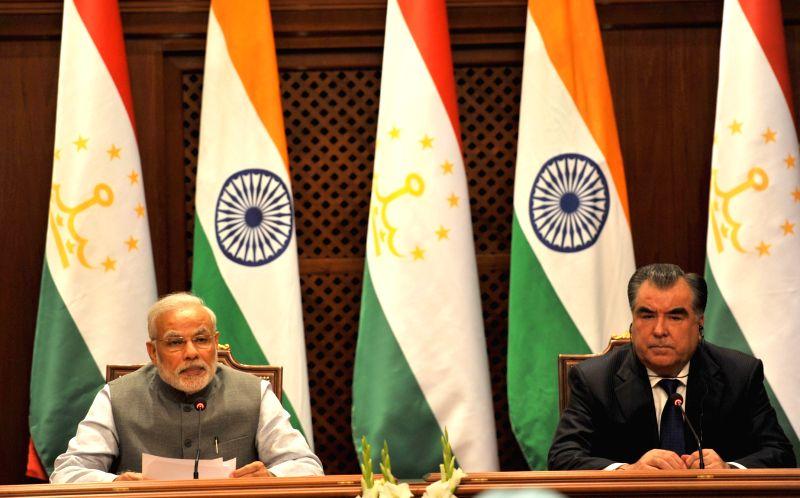Dushanbe (Tajikistan): Prime Minister Narendra Modi and the President of Tajikistan, Emomali Rahmon during a joint press conference at Qasr-e-Millat, in Dushanbe, Tajikistan on July 13, 2015. - Narendra Modi