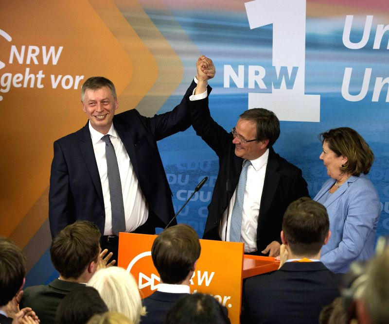 DUSSELDORF (GERMANY), May 14, 2017 Armin Laschet (C), Christian Democratic Union (CDU) leader in North Rhine-Westphalia, celebrates their victory in Dusseldorf, Germany, on May 14, 2017. ...