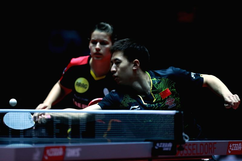 DUSSELDORF, June 1, 2017 - Fang Bo (R) of China and Petrissa Solja of Germany compete during the mix doubles third round match against Chuang Chih-Yuan and Chen Szu-Yu of Chinese Taipei at the 2017 ...