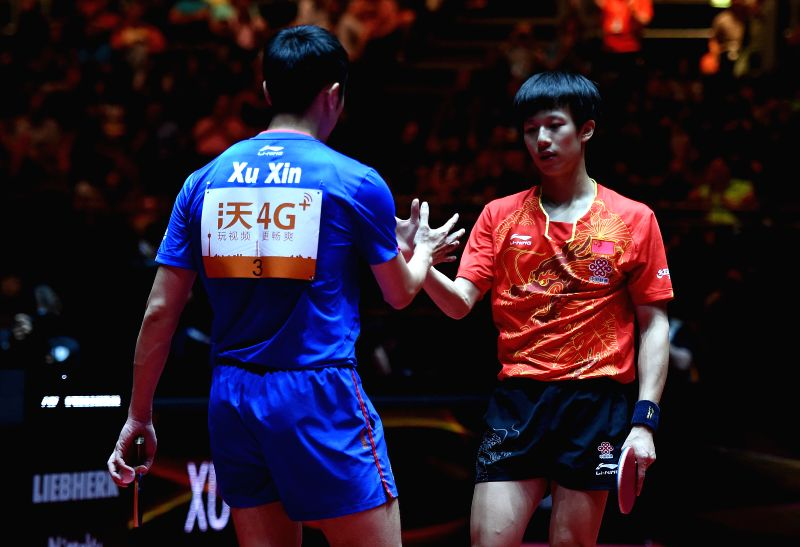 DUSSELDORF, June 4, 2017 - Lin Gaoyuan(R) of China greets his compatriot Xu Xin after the men's singles match at the 2017 World Table Tennis Championships in Dusseldorf, Germany, June 4, 2017.