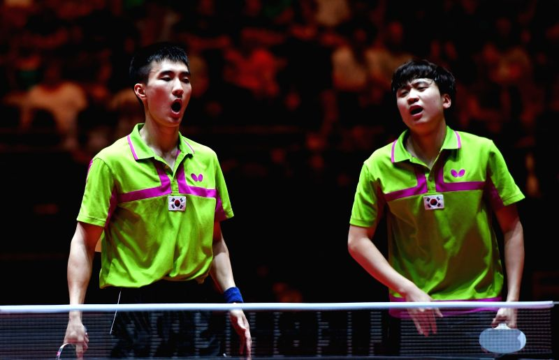 DUSSELDORF, June 4, 2017 - South Korea's Lee Sangsu (L) and Jeong Sangeun compete during the men's doubles semifinal match against Japan's Morizono Masataka and Oshima Yuya at the 2017 World Table ...