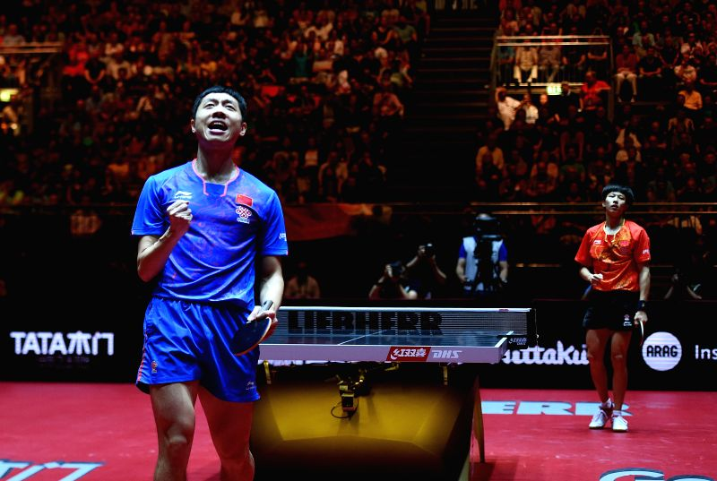 DUSSELDORF, June 4, 2017 - Xu Xin(L) of China celebrates after winning the men's singles match against his compatriot Lin Gaoyuan at the 2017 World Table Tennis Championships in Dusseldorf, Germany, ...