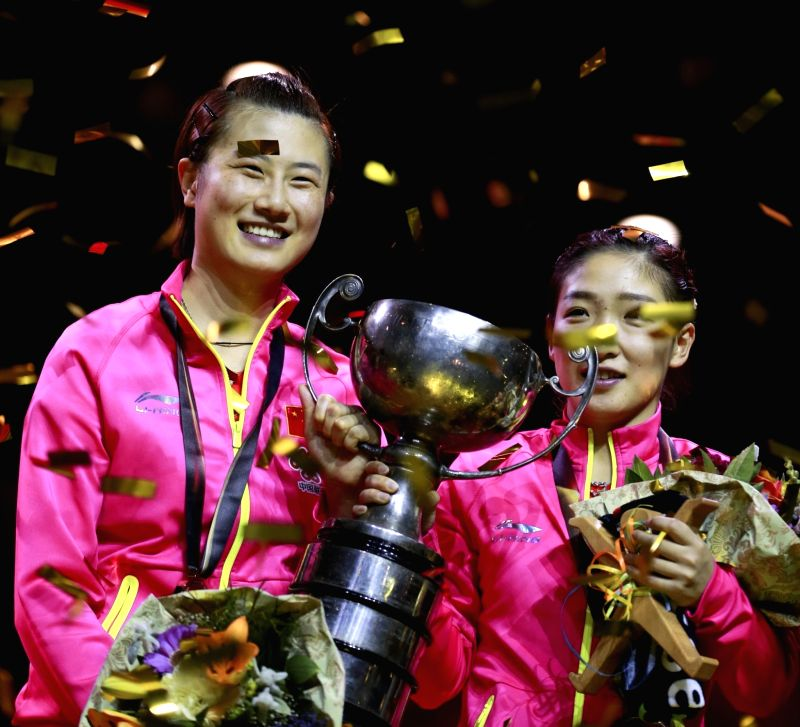 DUSSELDORF, June 5, 2017 - China's Ding Ning (L) and Liu Shiwen hold the trophy during the awarding ceremony for women's doubles final match at the 2017 World Table Tennis Championships in ...