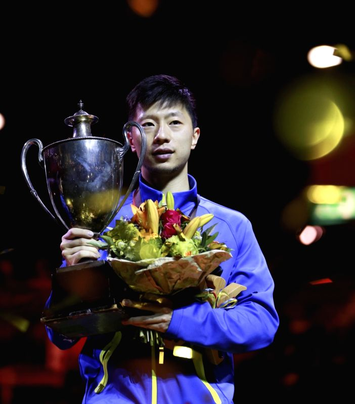 DUSSELDORF, June 5, 2017 - China's Ma Long holds the trophy during the awarding ceremony for men's singles final match at the 2017 World Table Tennis Championships in Dusseldorf, Germany, on June 5, ...