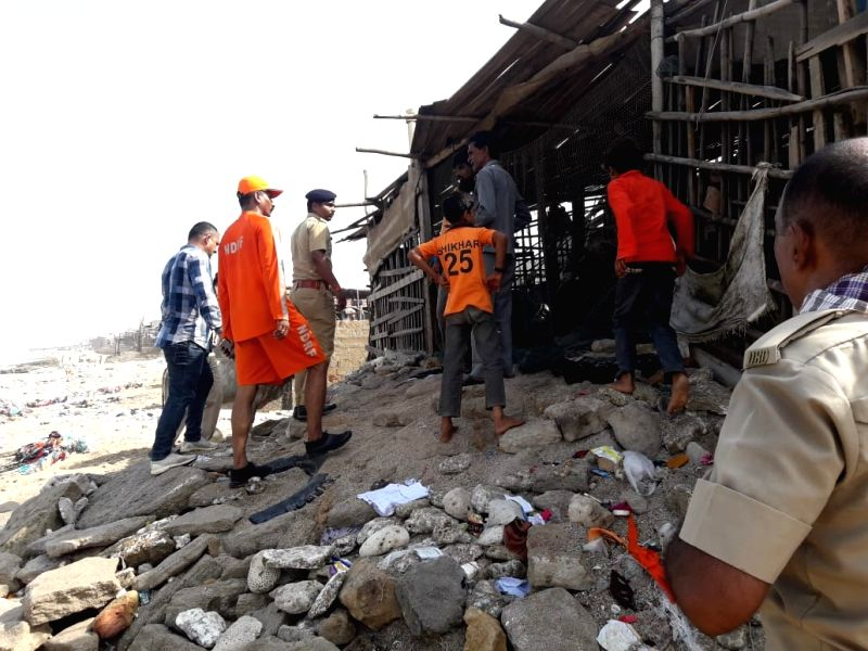 Dwarka: NDRF personnel carry out evacuation drive in Gujarat's Dwarka in the wake of Cyclone Vayu which is likely to hit the state's coast on Thursday; on June 12, 2019. (Photo: IANS/PIB)