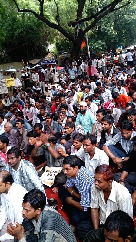 E-rickshaw operators protest against the ban in New Delhi on August 2, 2014.
