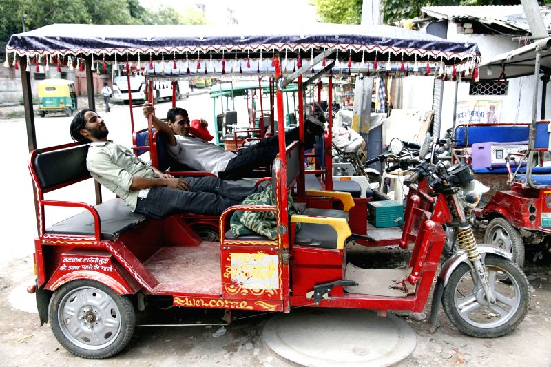E-rickshaws remain parked on Delhi roads as a High Court has imposed a ban on them till 14th August, 2014, on August 1, 2014.