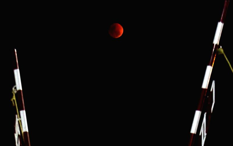 Earth's shadow falls on the moon during partial lunar eclipse; as seen from Chennai on Jan 31, 2018.