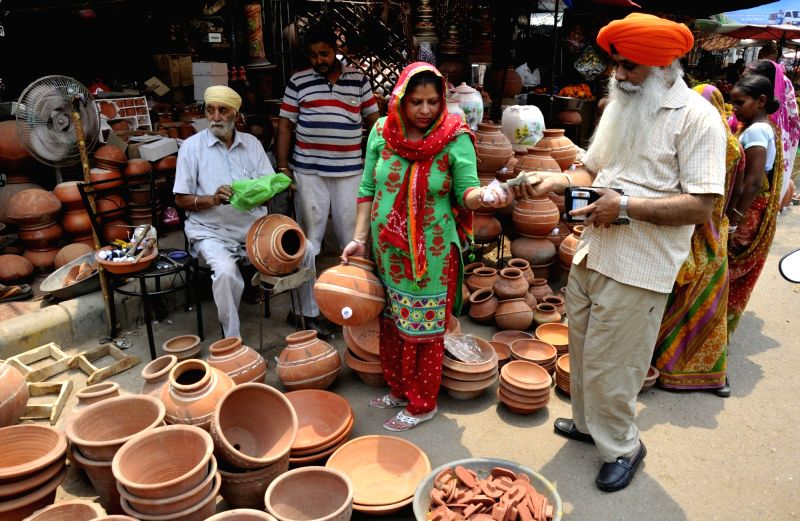 Earthen pots being sold on Amritsar roads as summers approach on May 9, 2017.