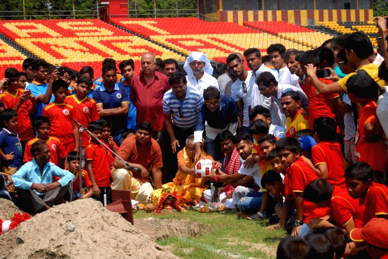 "East Bengal Club officials and young players perform rituals during ""Bar Puja"" as the club celebrates Poyla Baishakh - Bengali New Year, in Kolkata on Apr 15, 2018."