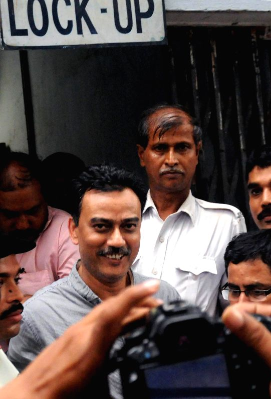 East Bengal Football Club official Debabrata Sarkar being taken to be produced at a Kolkata Court in connection with the multi-crore-rupee Saradha chit fund scam on Aug 21 2014.