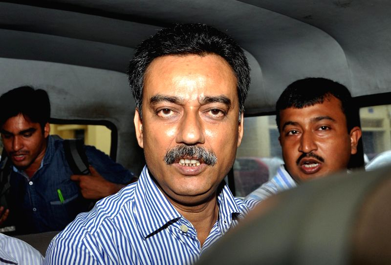 East Bengal Football Club official Debabrata Sarkar being taken to be produced at a Kolkata Court in connection with the multi-crore-rupee Saradha chit fund scam on Aug 29 2014.
