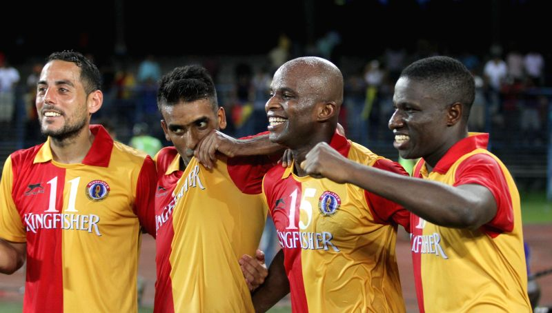 East Bengal players celebrate after winning a Calcutta Football League (CFL) match against Mohun Bagan in Kolkata on Aug 31, 2014.East Bengal won. Score: 3-1