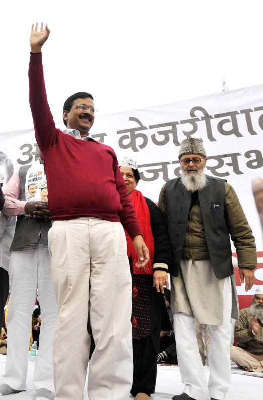 East Delhi: AAP Leader Arvind Kejriwal during his campaign for Delhi assembly election at Trilokpuri East Delhi on Feb. 3, 2015.