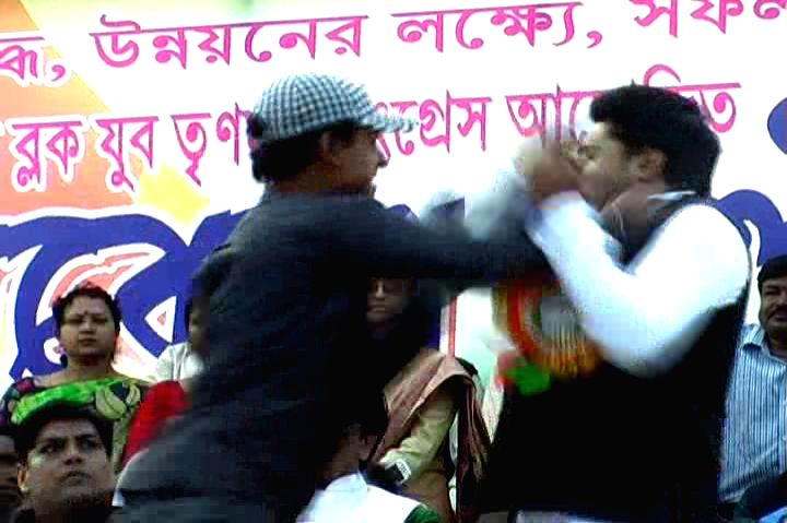 East Midnapore: An unidentified youth slaps West Bengal Chief Minister Mamata Banerjee's nephew and Trinamool Congress MP Abhishek Banerjee during a public meeting in West Bengal's East Midnapore ... - Mamata Banerjee and Abhishek Banerjee
