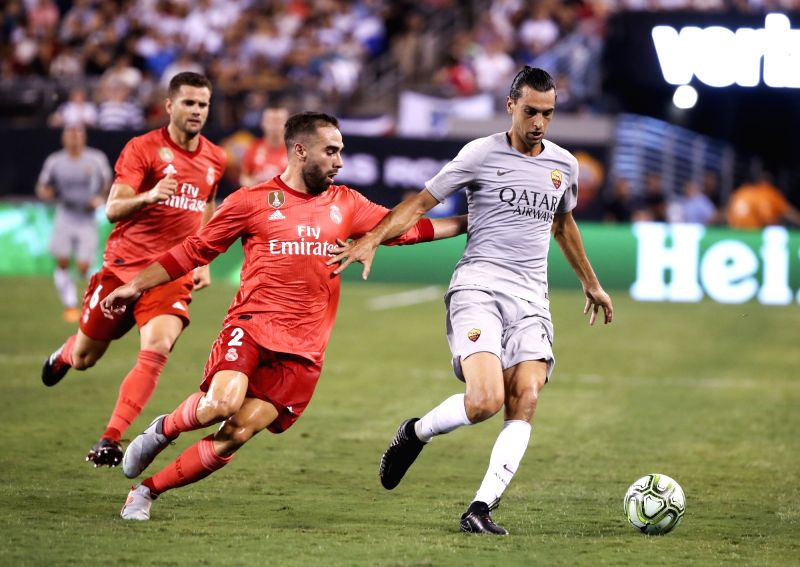 EAST RUTHERFORD, Aug. 8, 2018 - Real Madrid's Daniel Carvajal (C) vies with Roma's Javier Pastore during the International Champions Cup match between Real Madrid and AS Roma at MetLife Stadium in ...