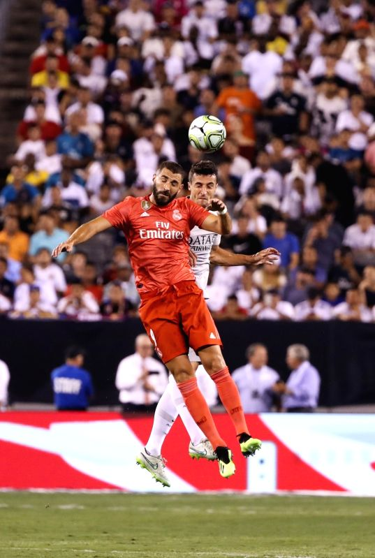 EAST RUTHERFORD, Aug. 8, 2018 - Real Madrid's Karim Benzema (front) heads the ball with Roma's Ivan Marcano Sierra during the International Champions Cup match between Real Madrid and AS Roma at ...