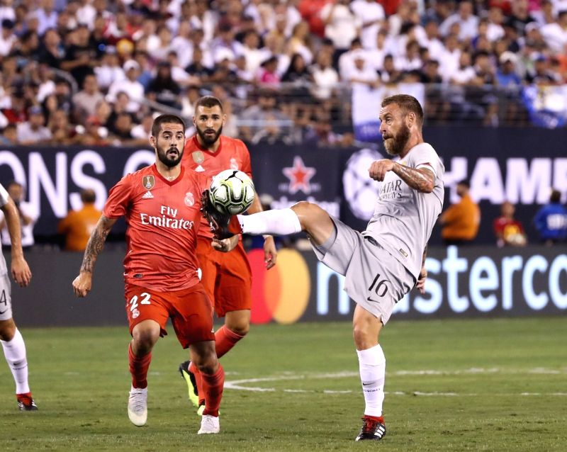 EAST RUTHERFORD, Aug. 8, 2018 - Roma's Daniele De Rossi (R) vies with Real Madrid's Isco during the International Champions Cup match between Real Madrid and AS Roma at MetLife Stadium in East ...