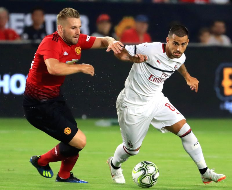 EAST RUTHERFORD, July 26, 2018 - Manchester United's Luke Shaw (L) and AC Milan's Suso competes during the International Champions Cup match between AC Milan and Manchester United at MetLife Stadium ...