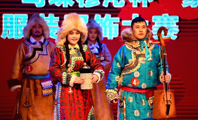 Herdsmen present creations during a competition of Mongolian winter clothing in East Ujimqin Banner, Xilin Gol League, north China's Inner Mongolia Autonomous .