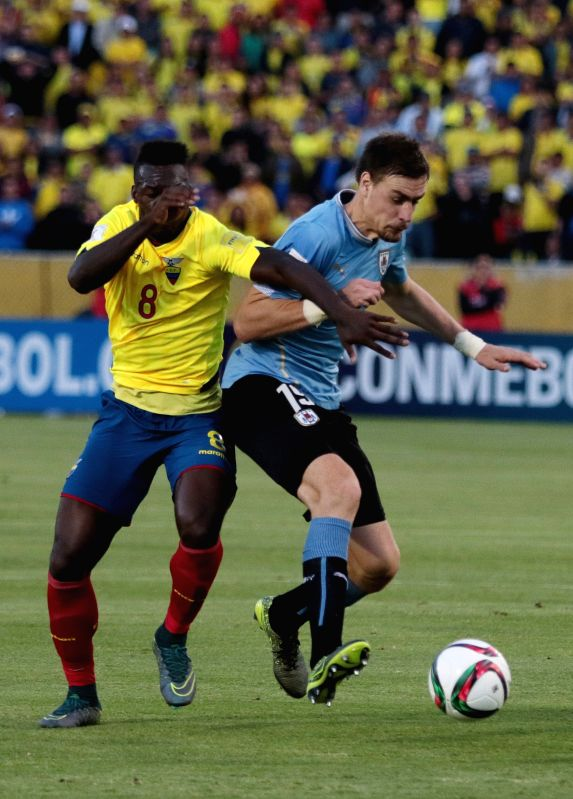 Ecuador's Felipe Caicedo (L) vies for the ball with Sebastian Coates of Uruguay during the qualifying match for the Russia World Cup 2018 at the Atahualpa Olympic ...