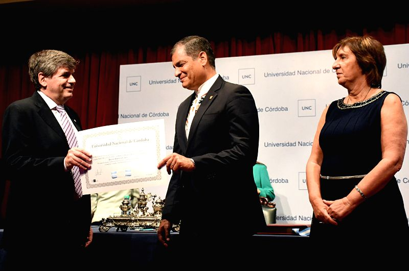 Ecuador's President Rafael Correa (C) receives the honorary doctorate degree from the Cordoba National University, in Cordoba, Argentina, on Dec. 9, 2015. ...