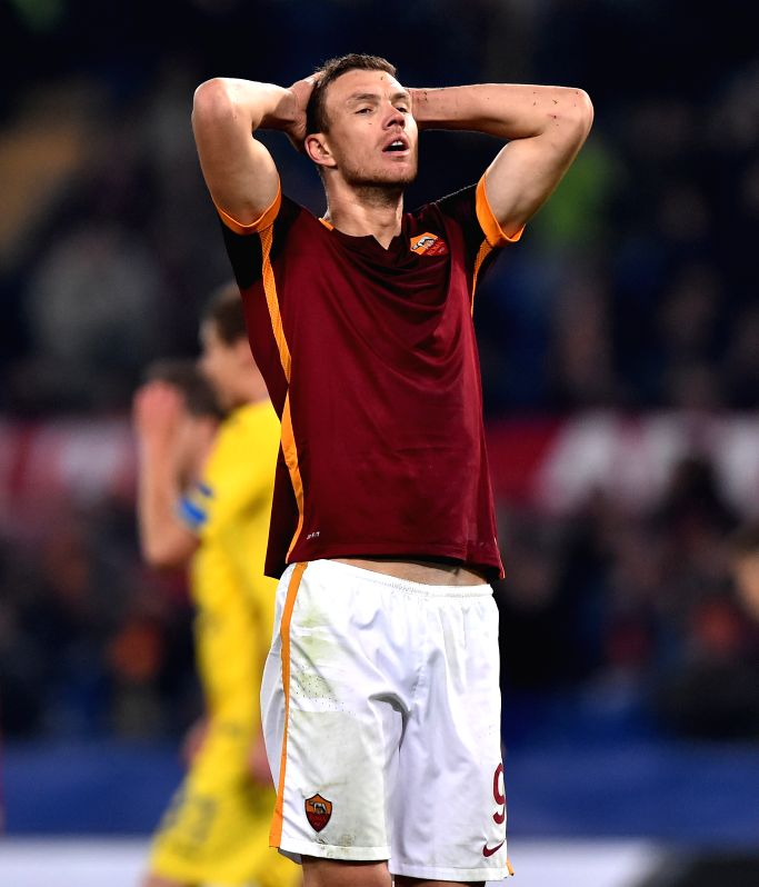 Edin Dzeko of Roma reacts during the UEFA Champion's League football against Bate Borisov in Rome, Italy, Dec. 10, 2015. Roma won 2-0.