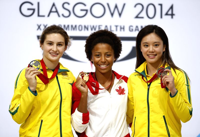 Gold medalist Jennifer Abel(C) of Canada poses with silver medalist Maddison Keeney (L) of Australia and bronze medalist Esther Qin of Australia during the medal ..